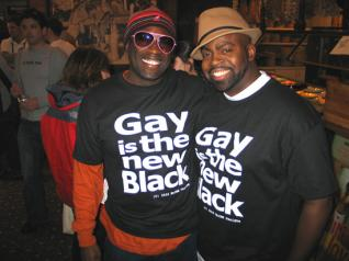 Black Gay Male Couple Smiles Widely, Wearing Matching T-Shirts: